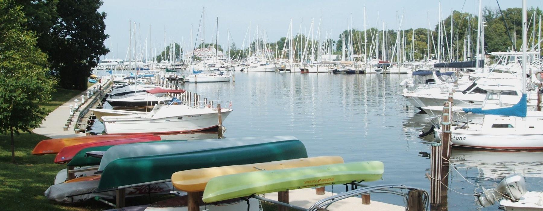 Marina with kayaks and sailing boats.