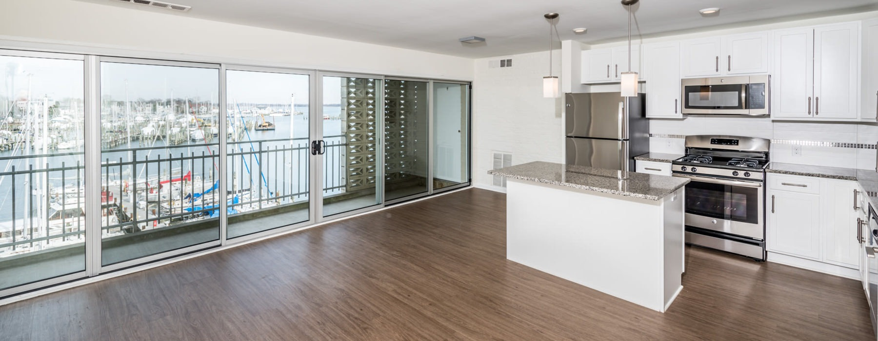 Open living area with kitchen island and access to living room.